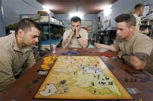 U.S. Army soldiers with the 293D Military Police Company, 97th Military Police Battalion, play board game 'Risk - The Game of Global Domination' as they relax at a local police station on the outskirts of the town of Kandahar, southern Afghanistan