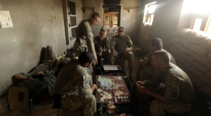 U.S. Army soldiers from Alpha Battery, 101st Airborne Division, play the board game Risk at patrol base Stronghold Lugo near Jellawar, Afghanistan.  By Patrick Baz, AFP/Getty Images